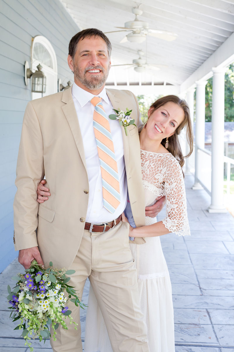 bride-and-groom-smile-on-porch