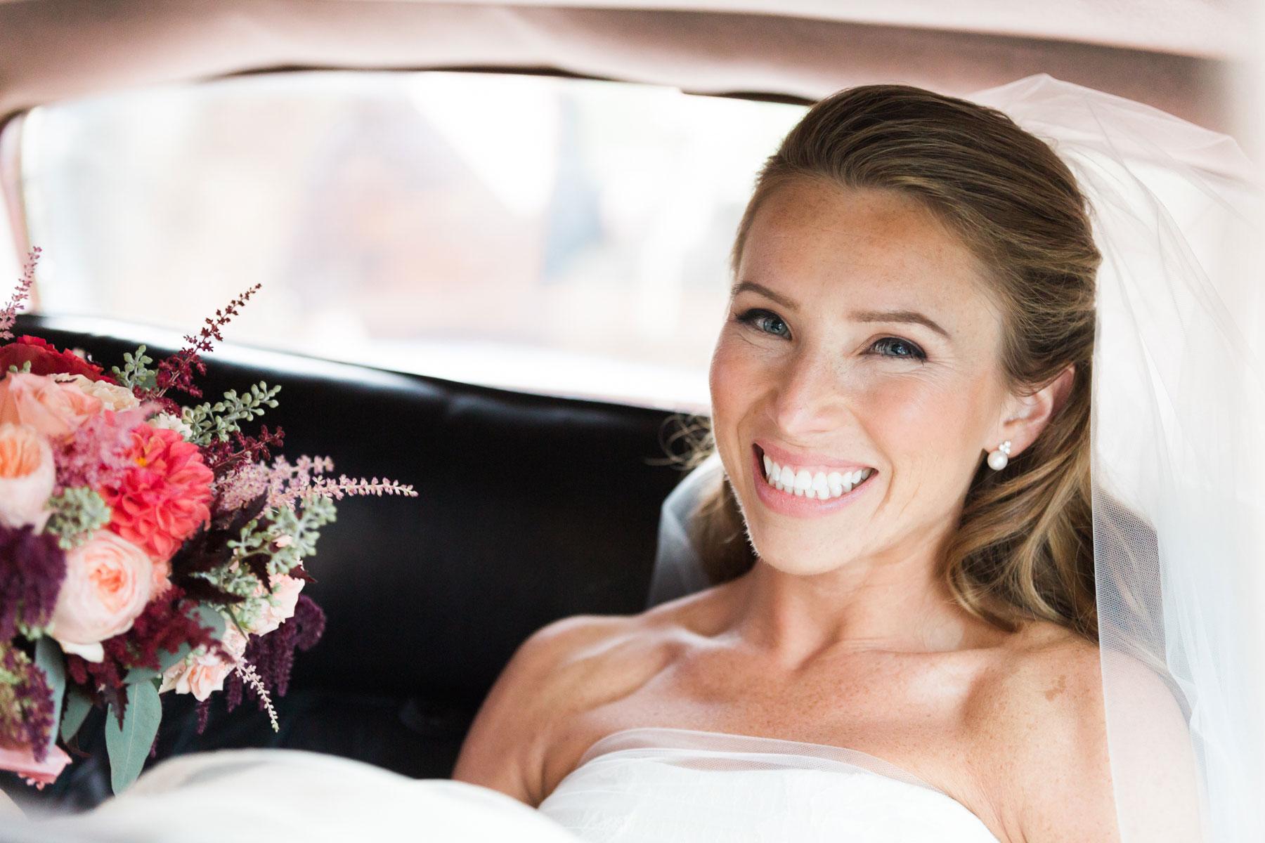 bride-smiles-in-car-middleburg-virginia-wedding