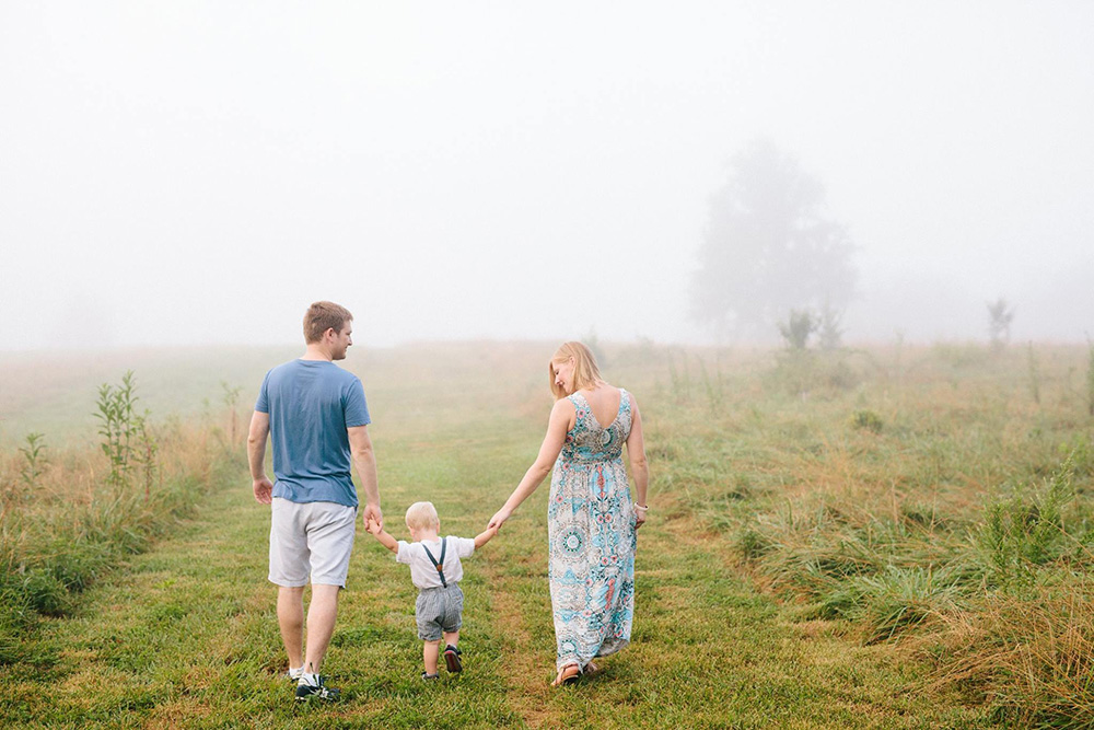 our-family-walking-away-through-field