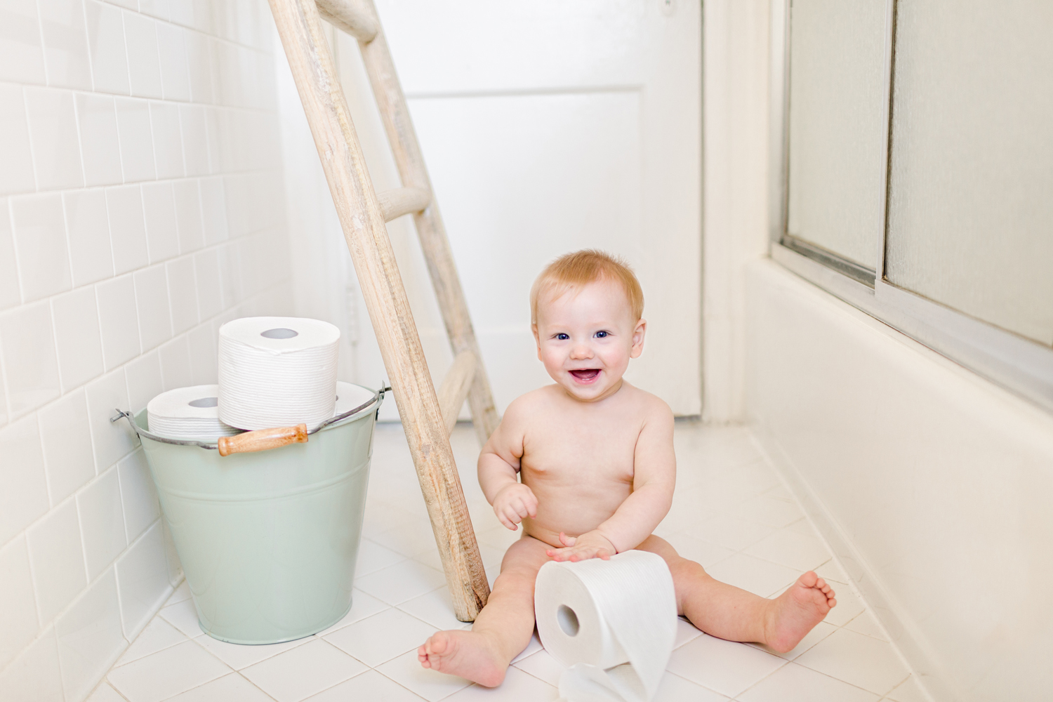 baby-boy-laughs-plays-with-toilet-paper
